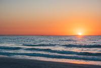 Sunset in dramatic orange sky over sea, Sorso, Sassari, Italy
