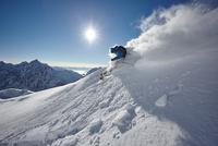 Male freestyle skier skiing down snow powdered mountainside, Zugspitze, Bayern, Germany