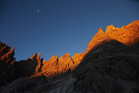 Golden rock face at sunset in the Dolomites, Sexten, South Tyrol, Italy