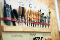 Row of tools in leather workshop