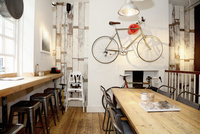 Quirky coffee shop interior with bicycle on wall