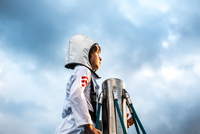 Portrait of boy in astronaut costume gazing out from top of climbing frame against dramatic sky 11015297720| 写真素材・ストックフォト・画像・イラスト素材|アマナイメージズ