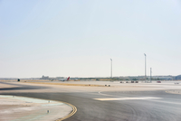 Airplanes in the distance on runway, Barajas Airport, Madrid, Spain