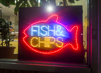Neon sign in fish and chip shop window