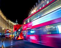 Blurred motion of buses on Regent Street, London, UK