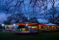 Fairground rides at amusement park, London, UK