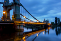 Hammersmith bridge illuminated in the evening, London, UK