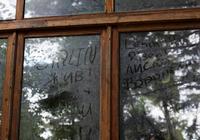 Graffiti written in dirt on window, Sochi, Russia
