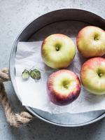 Fresh Honeycrisp apples on metal tray