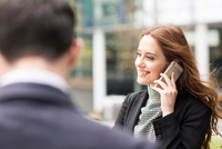Businesswoman in city making telephone call