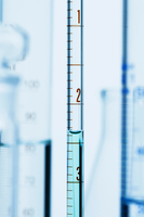 Meniscus. Curved surface (meniscus) of water in graduated pipette. Liquid volume measured by reading the scale at the bottom of