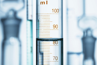Meniscus. Curved surface (meniscus) of water in graduated cylinder. Liquid volume measured by reading the scale at the bottom of