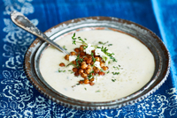 Bowl of cauliflower soup garnished with chickpeas