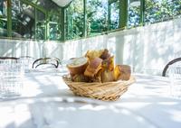 Sliced baguette in basket on restaurant table