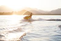 Man riding jet ski on lake, Beijing, China