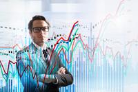 Conceptual image of businessman with graph data 11015298718| 写真素材・ストックフォト・画像・イラスト素材|アマナイメージズ