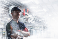 Conceptual image of factory worker in bottling plant