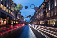 Christmas lights and traffic on Regent street at dusk, London, UK