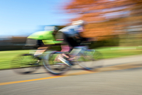 Blurred motion side view of cyclists cycling