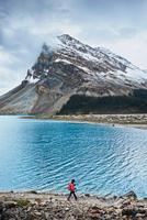 Hiker hiking along Bow Lake, Banff, Alberta, Canada