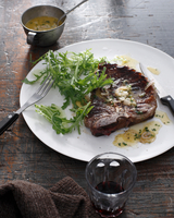 Bistro meal of T-Bone Steak with bercy sauce and red wine on table 11015303203| 写真素材・ストックフォト・画像・イラスト素材|アマナイメージズ