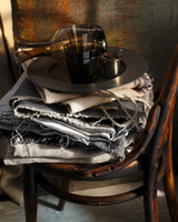 Stacked tablecloths and tray on bistro chair 11015303208| 写真素材・ストックフォト・画像・イラスト素材|アマナイメージズ