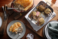 Bistro table with herb crusted lamb racks and rustic chicken pie 11015303223| 写真素材・ストックフォト・画像・イラスト素材|アマナイメージズ