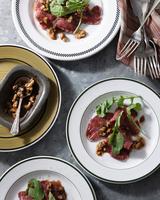 Bistro table with plates of beef carpaccio, rocket and walnuts 11015303228| 写真素材・ストックフォト・画像・イラスト素材|アマナイメージズ