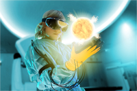 Boy in virtual reality headset interacting with digital floating sun