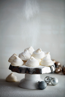 Meringues on cake stand and Christmas baubles