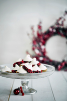 Christmas decorations and meringues on cake stand