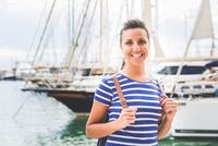 Woman sightseeing around marina, Mallorca, Spain