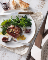 Filet mignon with garlic butter, mixed greens salad, red wine and crusty bread on plate in restaurant, close-up 11015304347| 写真素材・ストックフォト・画像・イラスト素材|アマナイメージズ