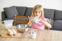 Young girl baking at home
