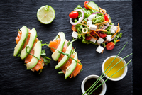 Smoked fish and avocado open sandwiches with salad and dipping sauces on slate, overhead view 11015304484| 写真素材・ストックフォト・画像・イラスト素材|アマナイメージズ