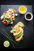 Smoked fish and avocado open sandwiches with salad and dipping sauces on slate, overhead view 11015304486| 写真素材・ストックフォト・画像・イラスト素材|アマナイメージズ