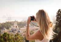 Woman with camera sightseeing, Malaga, Spain 11015305099| 写真素材・ストックフォト・画像・イラスト素材|アマナイメージズ