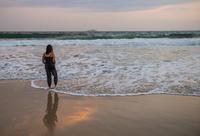 Woman paddling in lapping waves, Copacabana, Rio de Janeiro, Brazil