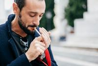 Man smoking cigarette 11015305879| 写真素材・ストックフォト・画像・イラスト素材|アマナイメージズ