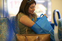 Mature woman searching shopping bag in train carriage 11015307253| 写真素材・ストックフォト・画像・イラスト素材|アマナイメージズ