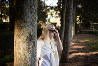 Woman in sunglasses strolling in vineyard woodland