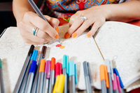 Cropped close up of woman coloring in