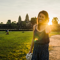 Woman in front of Angkor Wat temple, Siem Reap, Cambodia