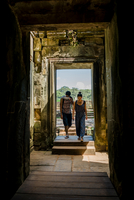 Couple entering doorway of Phimeanakas temple, Siem Reap, Cambodia