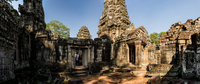 Man investigating Phimeanakas temple, Siem Reap, Cambodia
