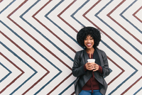 Portrait of woman in front of zig zag pattern wall