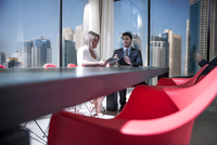 Businessman and woman meeting in conference room