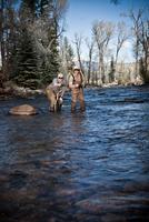 Fishermen ankle deep in river fly fishing, Colorado, USA 11015310679| 写真素材・ストックフォト・画像・イラスト素材|アマナイメージズ