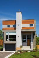 Grey and charcoal stone with cedar wood siding modern cube style home facade in summer, Quebec, Canada 11015311317| 写真素材・ストックフォト・画像・イラスト素材|アマナイメージズ