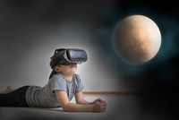 Young boy lying on floor, wearing virtual reality headset, looking at planet, digital composite 11015312126| 写真素材・ストックフォト・画像・イラスト素材|アマナイメージズ